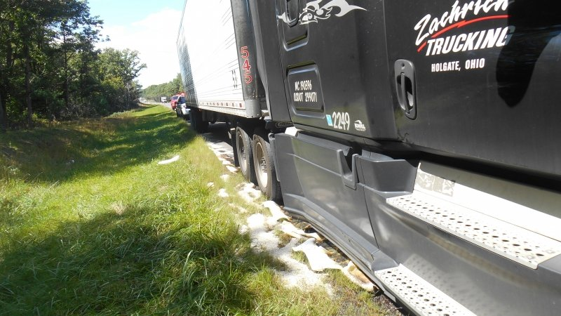 TRACTOR TRAILER RUPTURES SADDLE TANK ON INTERSTATE 80