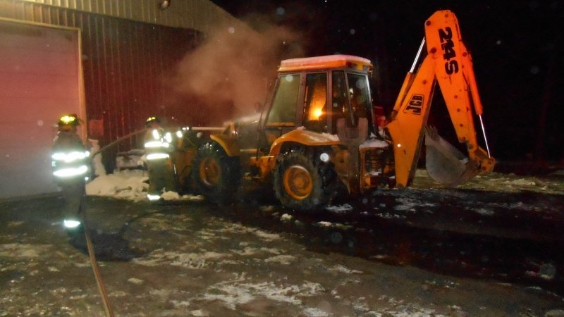 BACKHOE CATCHES FIRE IN SPLIT ROCK